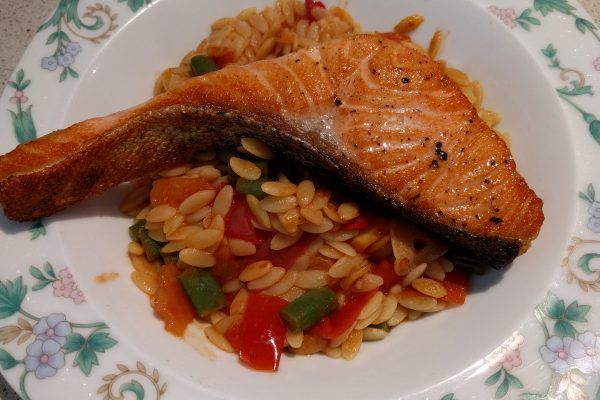 crispy salmon on tomato risoni